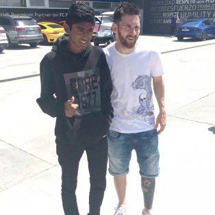 Lionel con Willian en Barcelona, tras el entrenamiento del equipo catalán.