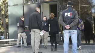 Personal de PDI realiza las primeras pericias en el Centro de Justicia Penal.