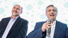 El precandidato a presidente Alberto Fernández junto al gobernador electo Omar Perotti (izquierda).