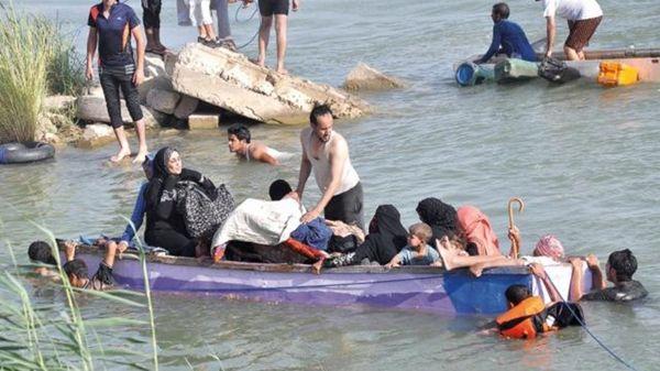 La población civil arriesga su vida para escapar del Estado Islámico (AP).