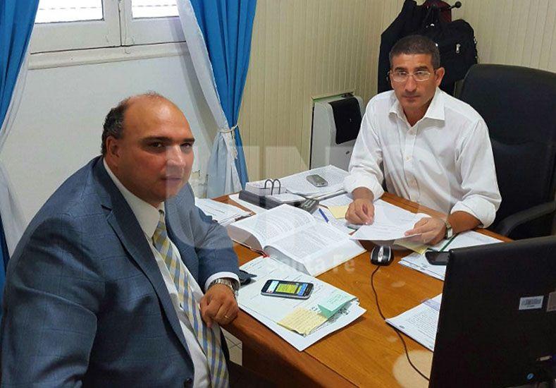 El fiscal Roberto Apullán junto al comisario principal Mario Monzón de la PDI.