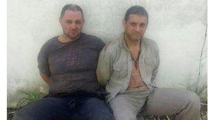 Cristian Lanatta y Víctor Schillaci al momento de ser detenidos el lunes en cercanías de Cayastá. (Foto: NA)