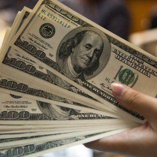 el dolar en santa fe trepa a 16,80 pesos y hay una fuerte caida de la bolsa en buenos aires