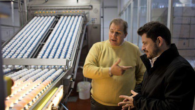 Marcos Castelló junto a Marcelo Perassi representante del grupo Compañía Avícola SA.
