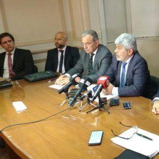 Argumentos. Baclini, flanqueado por los cinco fiscales regionales cuestionó los cambios introducidos.