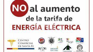 Cartel expuesto en las vidrieras del comercio santafesino en rechazo al aumento de la tarifa eléctrica