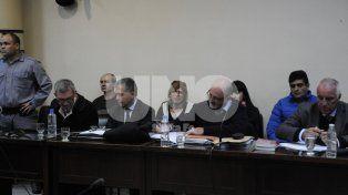 Los cuatro imputados en el banquillo de los acusados.