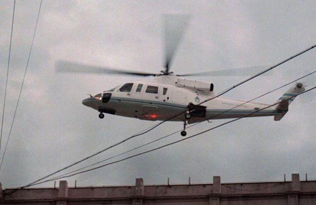 El ex presidente cuando se fue en helicóptero.