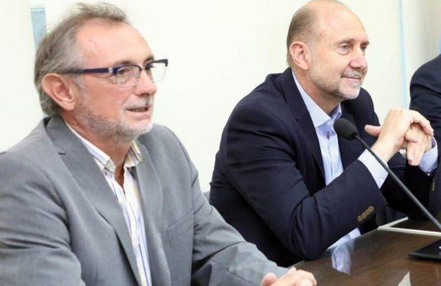 El ministro de la Producción, Daniel Costamagna, junto al gobernador, Omar Perotti.